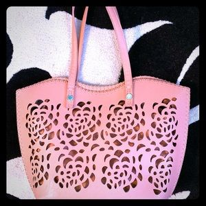 Laser cut, leather hand bag